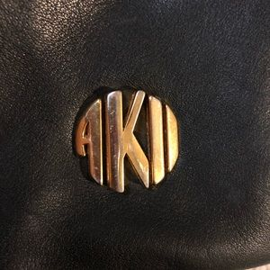 Anne Klein Bags - Vintage Anne Klein leather bucket crossbody